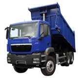 The dark blue lorry. With the lifted body isolated on a white background royalty free stock image