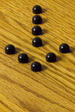Dark Blue Marbles Arrow Stock Photo