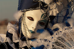 Dark blue masked woman Stock Photo