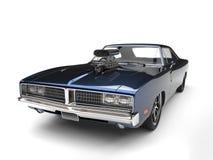 Dark blue metallic vintage American muscle car - closeup shot Royalty Free Stock Images