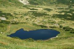 Dark blue mountain lake Royalty Free Stock Image