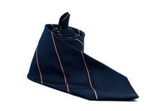 Dark blue necktie on white background Royalty Free Stock Photos
