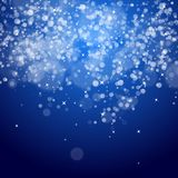 Dark blue night christmas background. With bokeh and stars Royalty Free Stock Image
