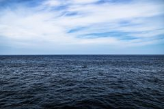 Dark blue ocean water with sunny, cloudy sky in open water in South Korea. Dark blue ocean water with sunny, cloudy and blue sky in open water in South Korea Stock Photo