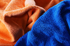 Dark blue and orange fabric with fibres Royalty Free Stock Photos