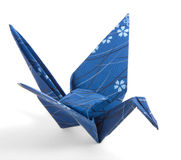 Dark Blue Origami Crane. Folded with a textured paper Royalty Free Stock Image