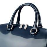 Dark blue patent handbag isolated on white background. Stock Images