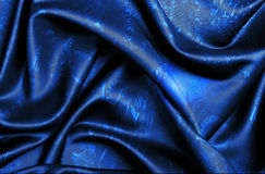 Dark Blue Patterned Fabric. Dark Blue silk fabric with pattern stock photography