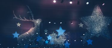 Dark blue pink lilac winter Christmas holidays night background with Christmas stars lights spotlights and stage Christmas decorat. Dark blue pink lilac winter royalty free stock image