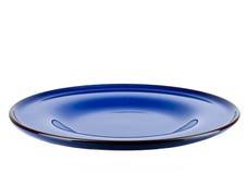 Dark blue plate isolated white background Royalty Free Stock Image