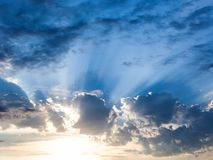 Dark blue rainy clouds over sunset in summer Stock Photo