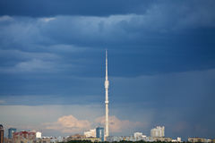 Dark blue rainy clouds over TV tower Stock Image