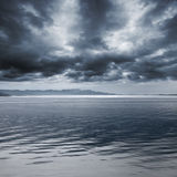Dark blue rainy marine landscape. Stormy sky Royalty Free Stock Images