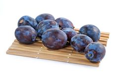 Dark blue ripe fleshy plums Royalty Free Stock Photos