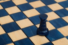 Dark blue rook on wooden chessboard Royalty Free Stock Image