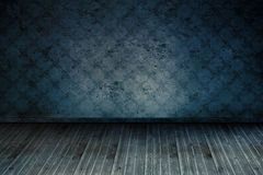 Dark blue room. With wallpaper and floorboards Stock Images