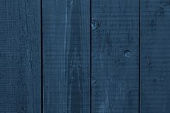 Dark blue rough wooden surface. Blue wooden boards. Wood plank texture background. Dark blue wooden table, fence, timber, panel. stock photo