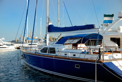 Dark blue sailing yacht on an anchor. In harbour Royalty Free Stock Image