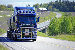 Dark Blue Scania R580 Trucking Uphill at Summer stock photography