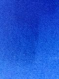 A dark blue screen. A dark blue screen which made from fabric is clean royalty free stock photography