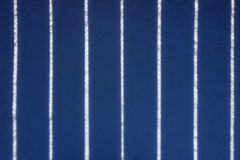 Dark blue shadow of a fence in the snow Royalty Free Stock Images