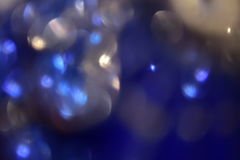 Dark blue shiny background. Dark blue shiny abstract bokeh light. Defocused background royalty free stock photography