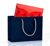 Dark blue shopping bag with gift Stock Photo