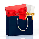 Dark blue shopping bag with gifts Stock Photography