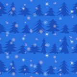 Dark blue silhouettes of pines on a blue background with white snowflakes. Seamless  pattern of winter fir forest at night. Snow in a coniferous forest. Dark Royalty Free Stock Photo