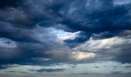 Dark blue sky. Beautiful scenery of cumulus clouds on a background of dark blue sky Stock Photo