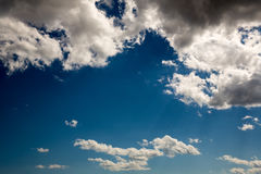 Dark blue sky background with clouds and shadow. Dark skyscape concept royalty free stock image