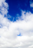 Dark blue sky behind dense clouds Stock Images