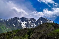 Dark Blue Sky with big Mountains covered with snow in Gilgit Pakistan royalty free stock image