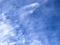 Dark blue sky with clean white clouds perfect for website banners, and background. Royalty Free Stock Image