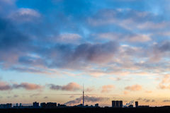Dark blue sky over city in cold winter sunrise Royalty Free Stock Photography