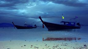 Dark blue sky over fishing man boats Thai Stock Images