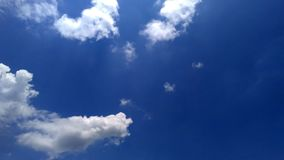 Dark Blue sky with white clouds Stock Image