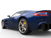 Dark blue sports car - back view Royalty Free Stock Photography