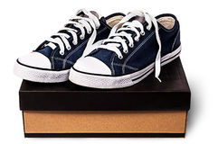 Dark blue sports shoes on the cardboard box Royalty Free Stock Image