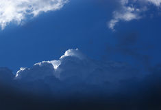 Dark blue storm cloud with a small white cloud edge Royalty Free Stock Photography