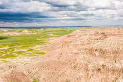 Dark blue storm clouds and bird in Badlands National Park Stock Images