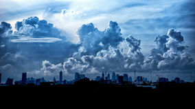 Dark blue storm clouds over city in rainy season Royalty Free Stock Images