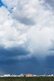 Dark blue storm clouds over urban district. In summer day Stock Photo