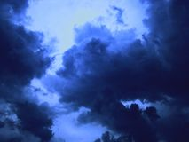 A dark blue storm in the sky. The clouds during the storm are sinister and terrible Stock Images