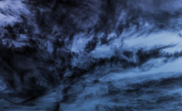 Dark blue stormy cloudy sky background photo Royalty Free Stock Photography