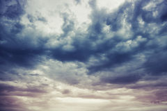 Dark blue stormy cloudy sky natural background Royalty Free Stock Image