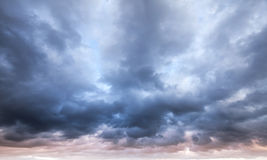 Dark blue stormy cloudy sky. Natural photo background Royalty Free Stock Photo