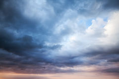 Dark blue stormy cloudy sky. Natural photo background Royalty Free Stock Images