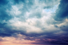 Dark blue stormy cloudy sky natural photo background, toned Stock Photos