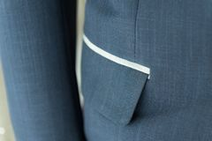Dark blue suit with pocket and white striped ,formal wedding groom suit. stock images